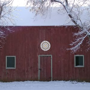 barn with sunny hex sign