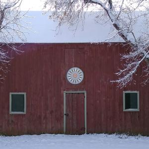 hex sign over barn door